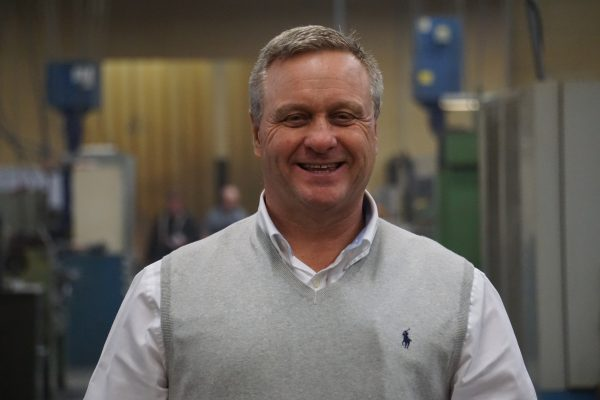Tom Blaszczykiewicz smiling for a picture.