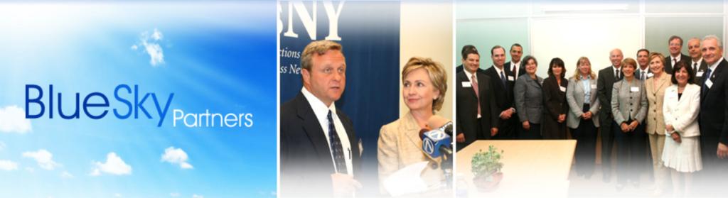 Tom Blaszczykiewicz stands next to Hilary Clinton and the INNEX Innovative team.