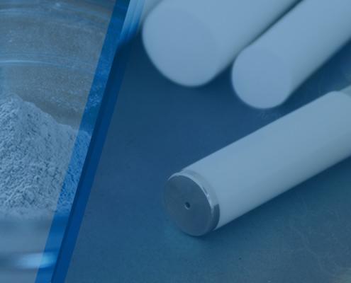 Ceramic powder next to ceramic tooling parts.